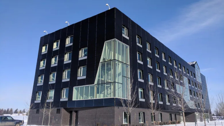 Red Deer College in Alberta has its east, west and south facades covered in solar glass cladding